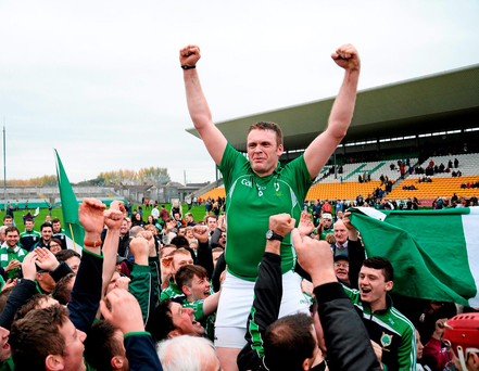 Coolderry's match winner Joe Brady is held aloft by supporters