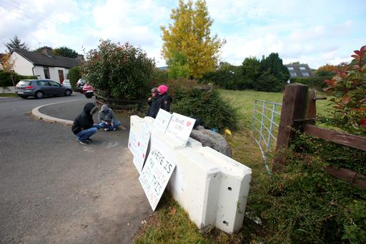 Protesters stand at the entrance to the disputed site at the end of Rockville Drive in Carrickmines, Co Dublin. Photo: Damien Eagers