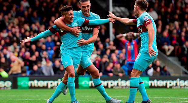 West Ham's goalscorer Manuel Lanzini celebrates with the provider Andy Carroll and Aaron Cresswell