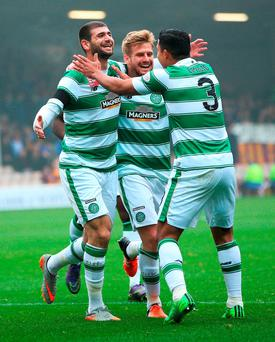 Nadir Ciftci celebrates scoring with Stuart Armstrong and Emilio Izaguirre