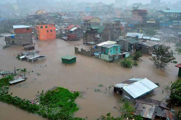 Houses, partially submerged in floods waters caused by heavy rains brought by Typhoon Koppu, are seen in City Camp Lagoon at Baguio city, north of Manila October 19, 2015