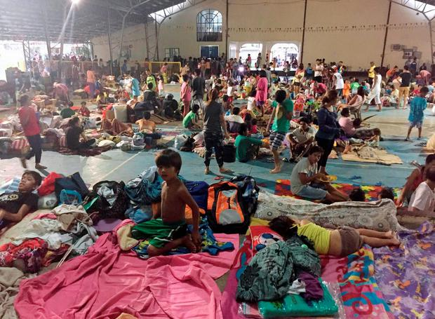 Residents stay at a public school which is being used as a temporary shelter, after typhoon Koppu battered Cabanatuan city, Nueva Ecija province, north of Manila October 19, 2015