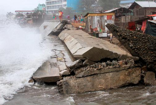 REFILE - CORRECTING GRAMMARA seawall project that protects residents along the sea shore, is seen collapsed and destroyed by strong waves brought by typhoon Koppu, in Ilocanos Norte town, San Fernando city, La Union province, north of Manila October 19, 2015
