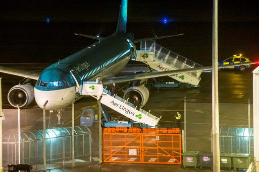 October 18, 2015: A garda technical team examines an Aer Lingus plane at Cork Airport on which a 24-year old man died. Photo: Daragh Mc Sweeney/Provision