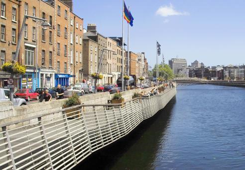 The Dublin boardwalk along the River Liffey Credit: William Murphy