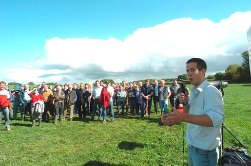 Breeding expert Donagh Berry talks to a group of farmers at a Teagasc beef open day.