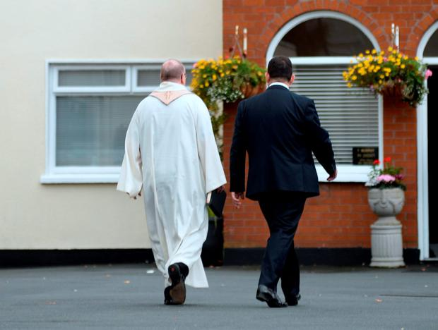19 Oct 2015; General view of priest arriving for prayer service for five of the Carrickmines victims. Thomas Murphy & Sons Funeral Directors, Boghall road, Bray, Co. Wicklow. Picture: Caroline Quinn