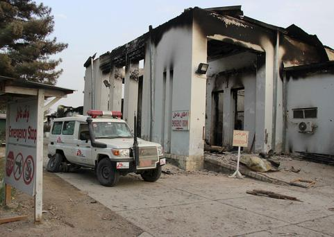 A vehicle is parked in front of a damaged building at Medecins Sans Frontieres (MSF) in Kunduz, Afghanistan October 16, 2015. The hour-long air raid on October 3, 2015 killed 22 people, including 12 MSF staff, and led to the closure of the Kunduz trauma hospital, depriving tens of thousands of Afghans of health care, the prominent medical charity said. Picture taken October 16, 2015.REUTERS/Stringer EDITORIAL USE ONLY. NO RESALES. NO ARCHIVE