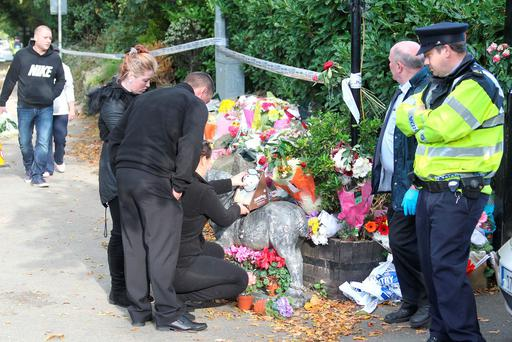 People pay their respects at Glenamuck Road South in Carrickmines, Co Dublin, in the aftermath of the tragic fire that claimed the lives of 10 members of the Travelling community. Photo Collins