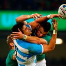 Robbie Henshaw challenges with Pablo Matera for the ball during Ireland's defeat