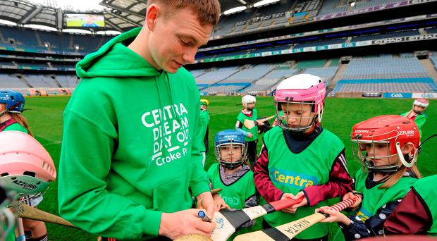 Waterford hurler Austin Gleeson signs hurleys for players from the An Ghaeltacht GAA Club in Waterford. Over 650 children travelled to Croke Park yesterday for a special day out as part of Centra's Live Well initiative