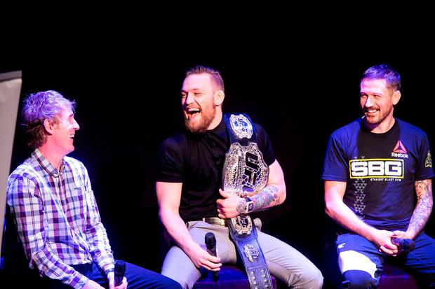Conor McGregor with Hector O hEochagain and John Kavanagh, Conor's trainer at the Wright Venue in Swords. Picture: Arthur Carron