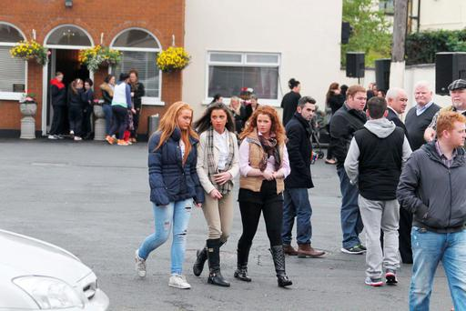 Mourners gather to pay their respects to five of the Carrickmines victims at a funeral home in Bray, Co Wicklow. Pictures: Caroline Quinn/Stephen Collins