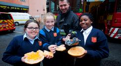 Firefighter Phil Kelly demonstrates the danger of fireworks with a plastic hand severed by a firework and a pumpkin blasted to bits by a firework to Millie Byrne (9), Emily Maher (10) and Esther Askin (9) from Clonburris National School, Clondalkin, Co Dublin. Photo: Gareth Chaney