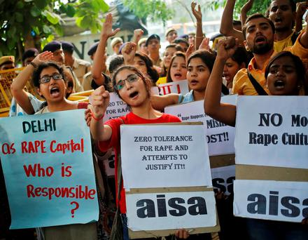Members of All India Students Association (AISA) shout slogans as they hold placards during a protest outside police headquarters in New Delhi, India, October 18, 2015. EUTERS/Anindito Mukherjee