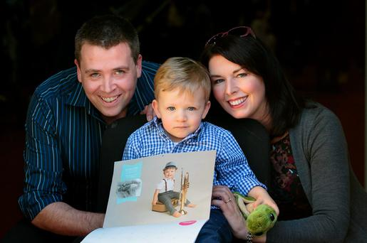 Fundraiser: Michael Davis, Georgina Couling, and their son, Mikey Derek Davis who features in the Coombe 2016 charity calendar. Photo: Gareth Chaney