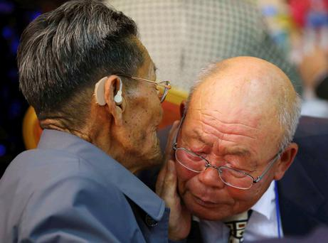North Korean Kim Duk Young (left), 82, talks with his South Korean younger brother Kim Chang-young, 80, during the separated family reunions at Mount Kumgang resort, North Korea, October 20, 2015. Reuters