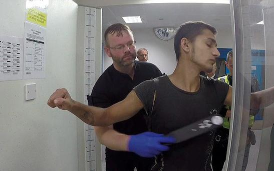 Zdenko Turtak being searched at Leeds' Elland Road Police Station in July Photo: West Yorkshire Police/PA