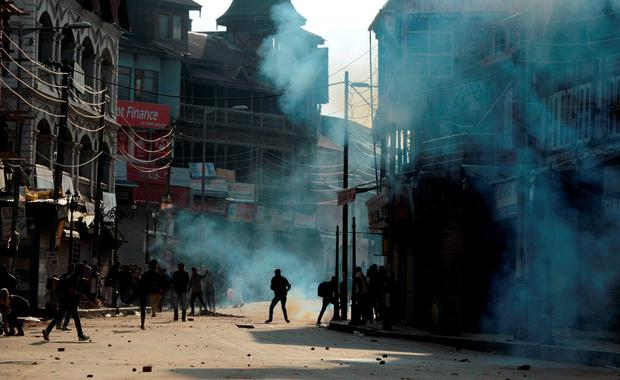 Indian Kashmiri protesters clash with Indian police during a protest in Srinagar Credit: Tauseef Mustafa
