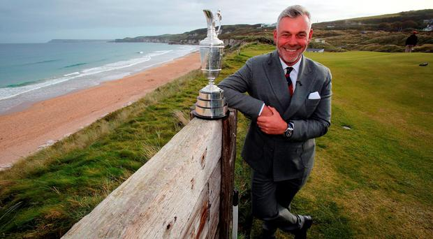 Darren Clarke with the British Open's Claret Jug trophy at Royal Portrush yesterday
