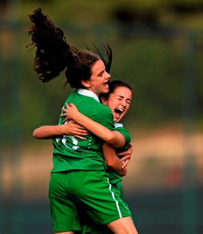 Ireland's Leanne Kiernan celebrates with Alex Kavanagh, right, after scoring her team's first goal against Turkey in the 2015-16 UEFA Women's U17