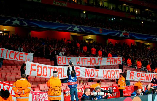 Empty seats in the stand as Bayern Munich fans protest against ticket prices prior the UEFA Champions League Group F match between Arsenal FC and FC Bayern Munchen at Emirates Stadium on October 20, 2015 in London, United Kingdom. (Photo by Paul Gilham/Getty Images)