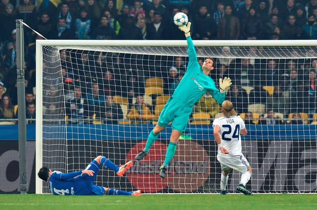 Chelsea's Bosnian goalkeeper Asmir Begovic makes a save during the UEFA Champions League football match Dynamo Kiev vs Chelsea, on October 20, 2015 at the Olympic stadium in Kiev. AFP PHOTO / GENYA SAVILOVGENYA SAVILOV/AFP/Getty Images