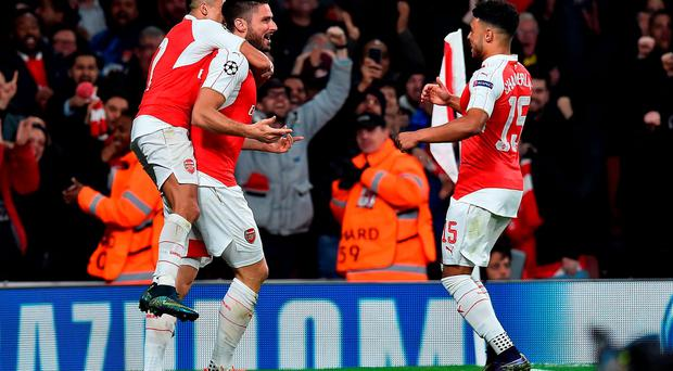 Arsenal's French striker Olivier Giroud (C) celebrates scoring his team's first goal with Alexis Sanchez (L) and Alex Oxlade-Chamberlain