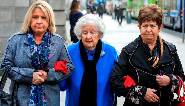 Ann Rudd (90) leaving court yesterday with her daughters Teresa Davey (left) and Anne Claxton (right). Photo: Courtpix