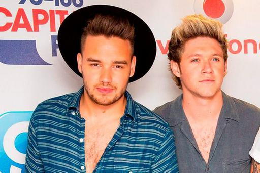 1D fans were left in tears last night after the band cancelled their gig in Belfast because Liam (left) was ill