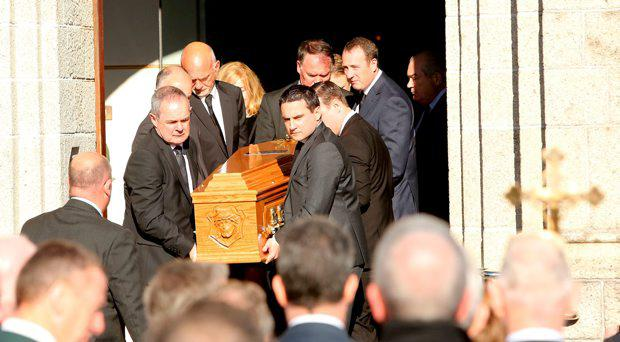 The remains of Hugh Cooney are taken from the church in Foxrock following his funeral mass