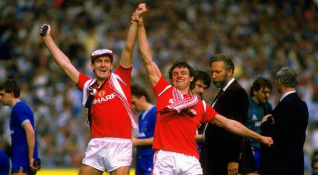 Manchester United pair Norman Whiteside and Kevin Moran celebrate FA Cup success in 1985