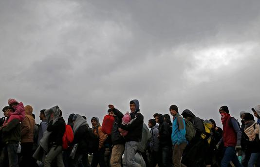 Migrants walk after crossing the border from Serbia in Bapska, Croatia October 20, 2015. Reuters/Dado Ruvic
