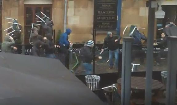 Fans hurling chairs at each other in Manchester