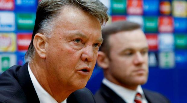 Manchester United's coach Louis van Gaal (L) and player Wayne Rooney attend a news conference on the eve of their Champions League group B soccer match against CSKA Moscow in Khimki. REUTERS/Sergei Karpukhin