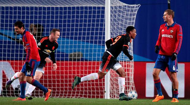 Manchester United's Anthony Martial, second right, celebrates with Wayne Rooney after scoring his side's equaliser