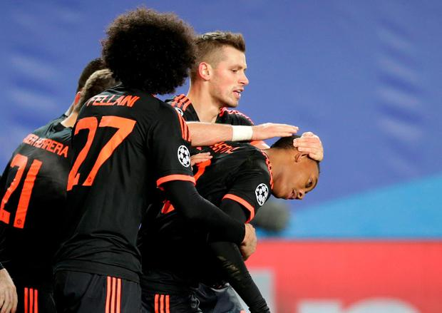 Manchester United's Anthony Martial, right, celebrates with team mates after scoring an equalizer during the Champions League Group B soccer match between CSKA Moscow and Manchester United at the Arena Khimki stadium in Moscow, Russia, on Wednesday, Oct. 21, 2015. (AP Photo/Pavel Golovkin)