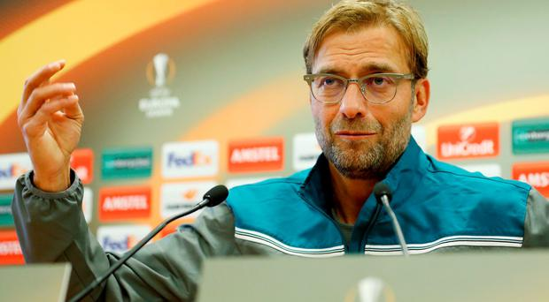 Jurgen Klopp answers questions at a press conference in Liverpool yesterday