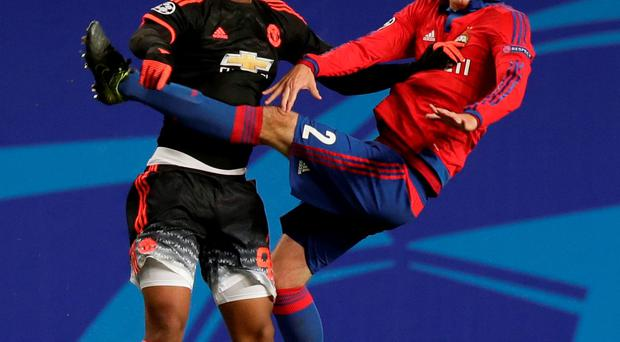 Manchester United's Anthony Martial, left, jumps for a header with Mario Fernandes of CSKA Moscow