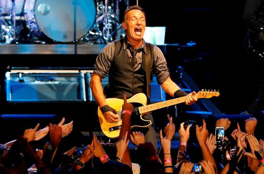 Singer Bruce Springsteen performs with the E Street Band during his concert in Cape Town, in this January 26, 2014 file photo