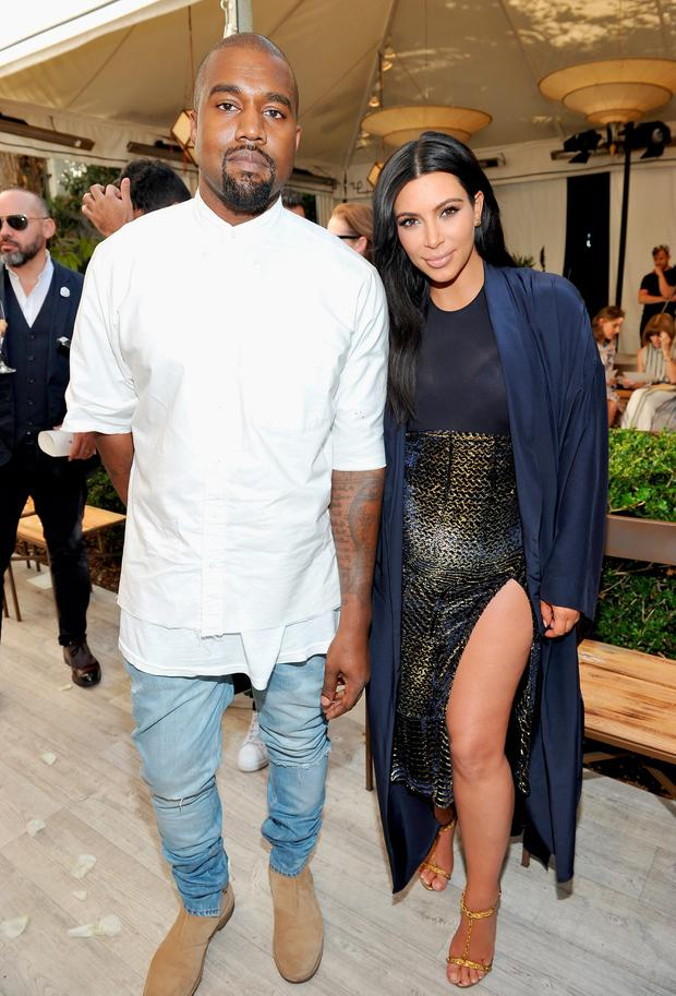 Recording artist Kanye West (L) and TV personality Kim Kardashian attend CFDA/Vogue Fashion Fund Show and Tea at Chateau Marmont on October 20, 2015 in Los Angeles, California. (Photo by Donato Sardella/Getty Images for CFDA/Vogue)