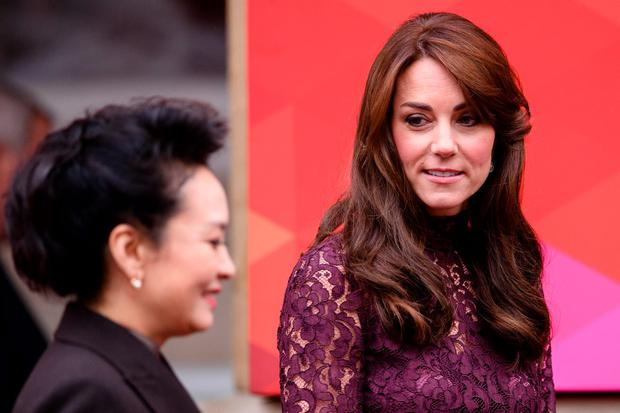 Britain's Catherine, Duchess of Cambridge (R), greets Chinese First Lady Peng Liyuan as she arrives at Lancaster House in London, on October 21, 2015, to attend a UK-China Creative Collaborations Summit. Britain and China are set to seal business contracts worth billions on Wednesday, the second day of President Xi Jinping's state visit, including on Britain's first nuclear power plant in decades. AFP PHOTO / LEON NEAL (Photo credit should read LEON NEAL/AFP/Getty Images)