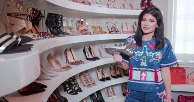 Kylie Jenner has shown off her wardrobe complete with a room just for her shoes. Here she holds the Louboutins Khloe bought her for her 16th birthday