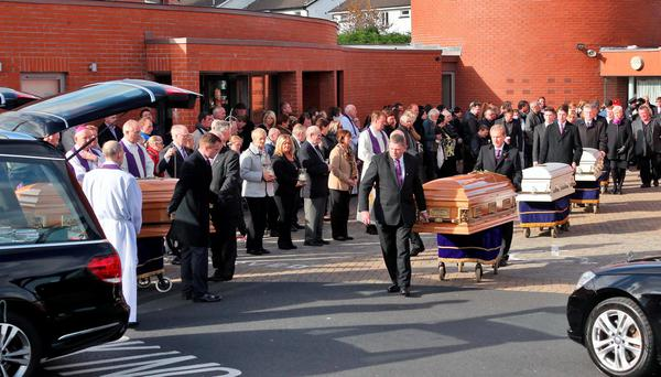 The remains are taken from the church at the funeral of Thomas, Sylvia, Christopher, Jim and baby Mary Connors, who died in the Carrickmines temporary halting site fire almost two weeks ago. Photo: Colin Keegan, Collins Dublin.