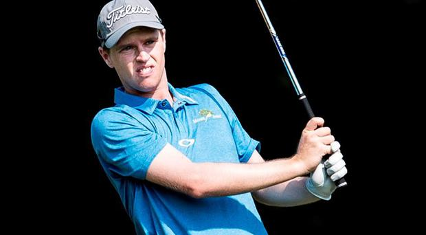 Kevin Phelan plays his second shot on the 15th hole during the first round of the Hong Kong Open
