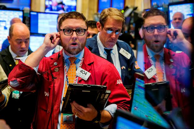 Traders work on the floor of the New York Stock Exchange shortly after the opening of the markets in New York. Photo: Reuters