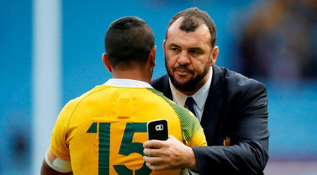 Australia head coach Michael Cheika celebrates with Kurtley Beale during Rugby World Cup