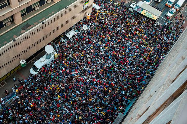 Students from Johannesburg and Wits universities arrive at the African National Congress ruling party headquarters to protest against university fee hikes Credit: Mujahid Safodien (AFP)