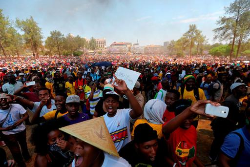 African police fired stun grenades and used water cannon on Friday to douse fires lit by students protesting Credit: Siphiwe Sibeko (REUTERS)
