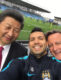 Manchester City striker Sergio Aguero managed to grab a snap with British Prime Minister David Cameron and Chinese President Xi Jingping.